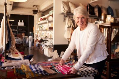 elder woman folding the clothes